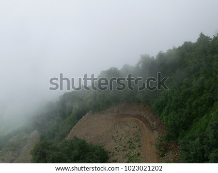 Strong fog in the mountains, thick fog, mountains in the fog #1023021202