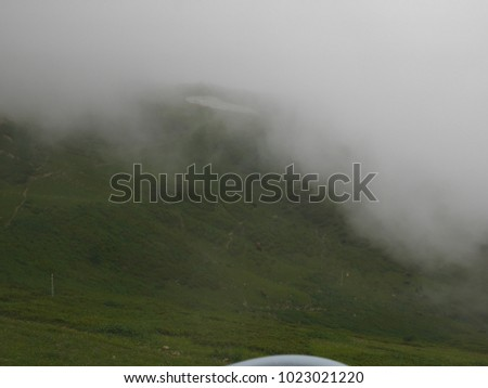 Strong fog in the mountains, thick fog, mountains in the fog #1023021220