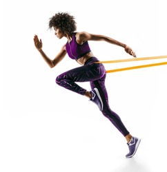 Strong girl in silhouette using a resistance band. Photo of young african girl performs fitness exercises isolated on white background. Side view
