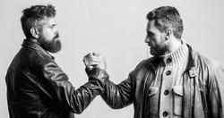 Strong handshake. Friendship of brutal guys. Leadership concept. True friendship of mature friends. Male friendship. Brutal bearded men wear leather jackets shaking hands. Real men and brotherhood.