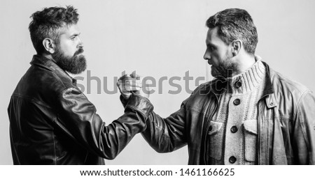 Strong handshake. Friendship of brutal guys. Leadership concept. True friendship of mature friends. Male friendship. Brutal bearded men wear leather jackets shaking hands. Real men and brotherhood. Сток-фото ©