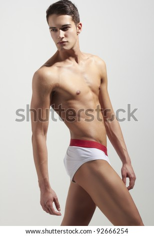 Strong handsome fitness sports man in underwear