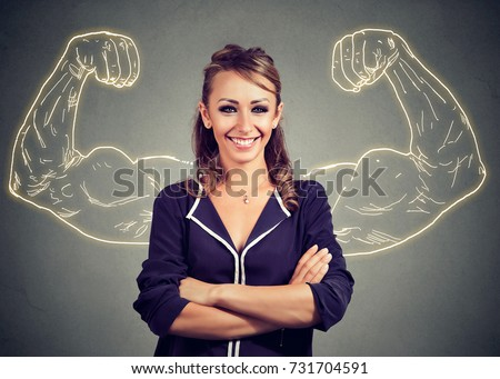 Strong happy woman on gray background   Foto stock ©