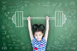 Strong kid with weight lifting doodle on school chalkboard for equal opportunity awareness on gender-children rights, international day of girl child, and sports for development and peace concept