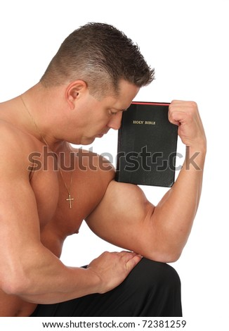 Strong man holding Holy Bible