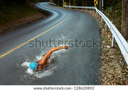 Shutterstock Strong Man Swim On Asphalt Road