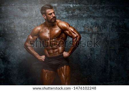 Strong Muscular Men Posing, Flexing Muscles