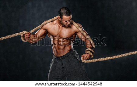 Strong Muscular Men Trapped in Ropes. Bodybuilder Trapped in Ropes
