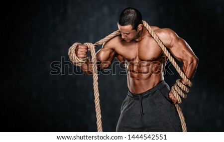 Strong Muscular Men Trapped in Ropes. Bodybuilder Trapped in Ropes #1444542551