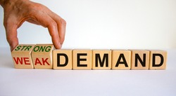 Strong or weak demand symbol. Businessman hand turns cubes and changes words 'weak demand' to 'strong demand'. Beautiful white background. Business and strong demand concept. Copy space.