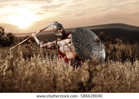 Strong Spartan warrior in battle dress with a shield and a spear Zdjęcia stock ©