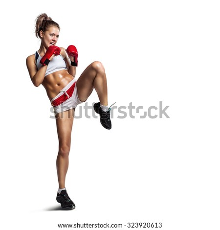 Strong sportswoman in boxing gloves prepared higt kick. Isolated on white background