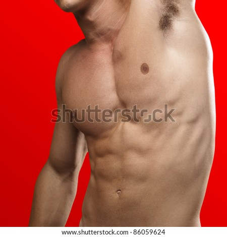 strong torso of a young man on a red background
