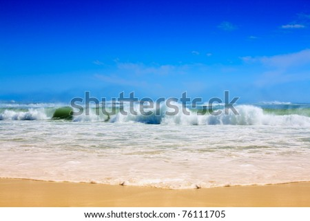 Strong waves crash over the beach