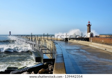 Strong waves hitting the breakwaters and the lighthouses ストックフォト ©