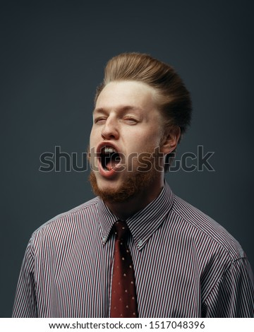 Strong wind blowing in male face, funny emotion