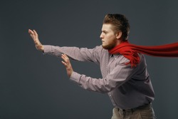 Strong wind blowing on man in red scarf