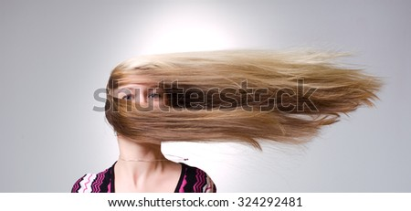 Strong wind blows on woman's hair