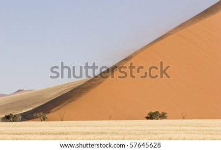 Strong wind is shaping a big dune in the evening light, Namib Desert, Namib-Naukluft National Park, Republic of Namibia, Southern Africa