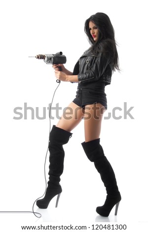 Strong Woman - Tall brunette in high heel boots and short shorts shows her independence by using power tools