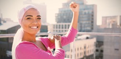 Strong woman wearing mantra scarf in the city with breast cancer awareness