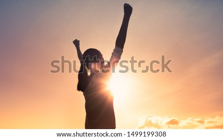 Strong woman with fist in the air. People power, and determination.