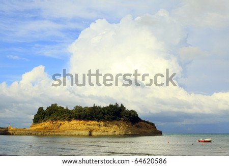 "Strongly bedded eroding sandstone formations at Sidari, north Corfu, under a dramatic sky. The popular resort has marketed its sandstone bays as the ""Canal d'amour""."