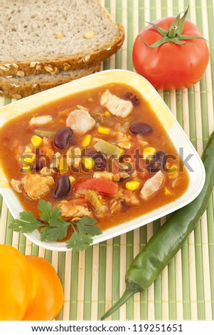 strongly spicy Mexican soup with vegetables in bowl