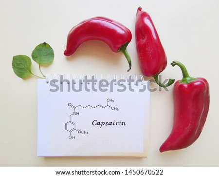 Structural chemical formula of capsaicin molecule with red chili peppers. Capsaicin is a chili pepper extract with analgesic properties, and an active component of chili peppers. Stock photo ©