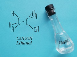 Structural chemical formula of ethanol molecule with a glass bottle of ethanol. Ethanol (ethyl alcohol) is a chemical compound, a simple alcohol with the chemical formula C2H6O.