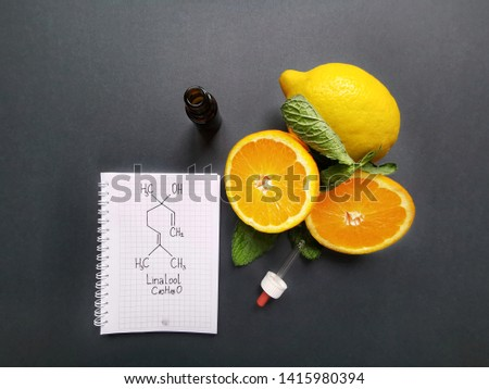 Structural chemical formula of linalool with fresh citrus fruit and cosmetic glass bottle. Linalool is an aromatic terpene, major component of essential oils. It is used in floral fragrances. #1415980394
