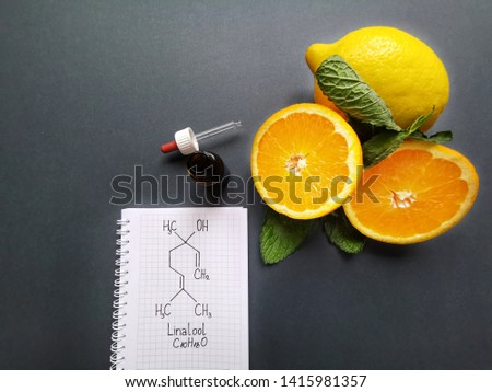 Structural chemical formula of linalool with fresh citrus fruit and cosmetic glass bottle. Linalool is an aromatic terpene, major component of essential oils. It is used in floral fragrances. #1415981357