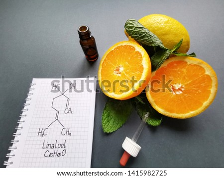 Structural chemical formula of linalool with fresh citrus fruit and cosmetic glass bottle. Linalool is an aromatic terpene, major component of essential oils. It is used in floral fragrances. #1415982725