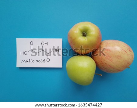Structural chemical formula of malic acid molecule. Malic acid is the main acid in many fruits, including apples. Malic acid contributes to the sour taste of fruits and is used as a food additive.