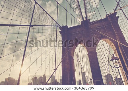 Structural detail of the Brooklyn Bridge looking up at the network of cables close to a central tower, New York, USA