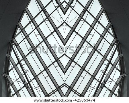 Structural glass ceiling / roof / wall of an office building / shopping mall. Abstract contemporary architecture with all-over glazing. #425863474