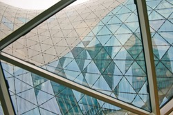 Structural glass facade curving roof of fantastic office building. Modern and Contemporary architectural fiction with glass steel column.