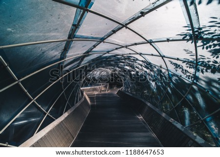 Structural glass facade curving roof of fantastic office building. Modern and Contemporary architectural fiction with glass steel column.Abstract architecture fragment.  Anyang art park in korea #1188647653