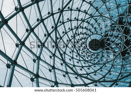 Structural glass facade curving roof of fantastic office building. Modern and Contemporary architectural fiction with glass steel column.Abstract architecture fragment. #505608061