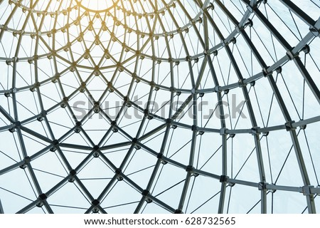 Structural glass facade curving roof of fantastic office building. Modern and Contemporary architectural fiction with glass steel column.Abstract architecture fragment. #628732565