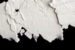 Structural plaster white on a black background. White Cream. paint smear. Plasticine.