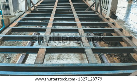 Structural steel channel for plane house building. Foundation construction site making reinforcement metal framework for pouring concrete to home building.