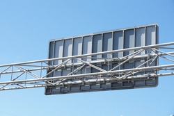 Structure back of metal traffic sign board, steel beams supported behind. Blue sky background. Concept of structure, traffic sign , traffic board.