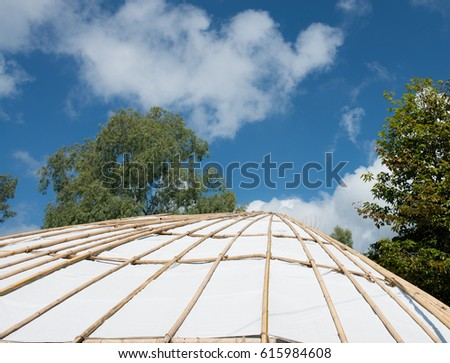 Structure  by bamboo of tent with tree and blue sky, Tensile membrane fabric roof on blue sky with clouds, dome for tourist resting, Roof with tree and blue sky #615984608