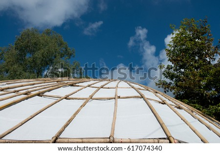 Structure  by bamboo of tent with tree and blue sky, Tensile membrane fabric roof on blue sky with clouds, dome for tourist resting, Roof with tree and blue sky #617074340