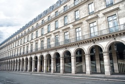 Structure in classical style. Palace with arch shaped structure. Old building in Paris France. Architecture and structure. Exterior structure. Architectural style. Landmark tour and trip.