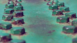 Structure of green metal beams with rivets. Steel girder bridge structure, Old painted metal background. Selective focus