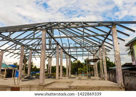 Structure of houses, pillars and concrete floors, roof structures using steel in construction #1422869339
