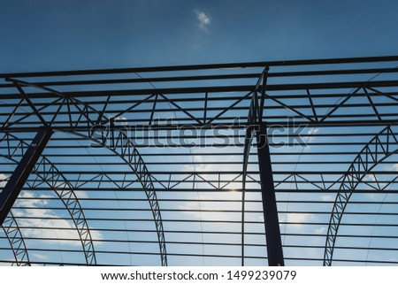 Structure of steel for building construction on sky background,Strength concept, creative idea Steel structure-pictures #1499239079