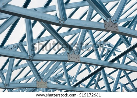 Structure of steel roof frame for building construction on sky background. - Shutterstock ID 515172661